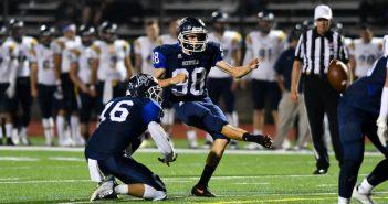 Corey Pooler kicking football