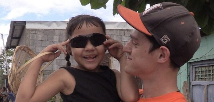 Corey Pooler and a girl in Nicaragua