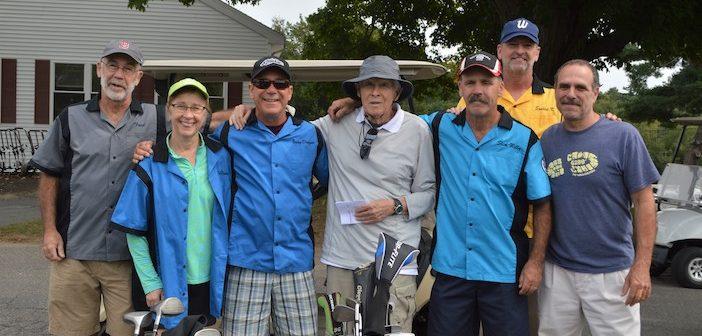 Left to right: Dan Dunn '78, Regina Hopkins Buckley '81, Jim Dunn, Coach Jerry Gravel, Bill Dunn, Kevin Farren, and Mark Asaro.