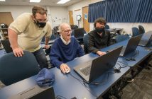 CIT lab assistants Cameron Young, and Sam Petrone help WSu faculty member Karl Leiker update his meteorology page.