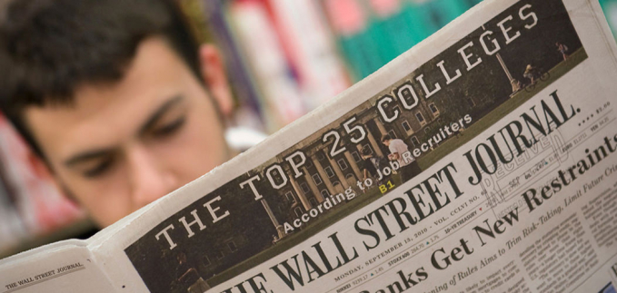 boy reading the Wallstreet Journal