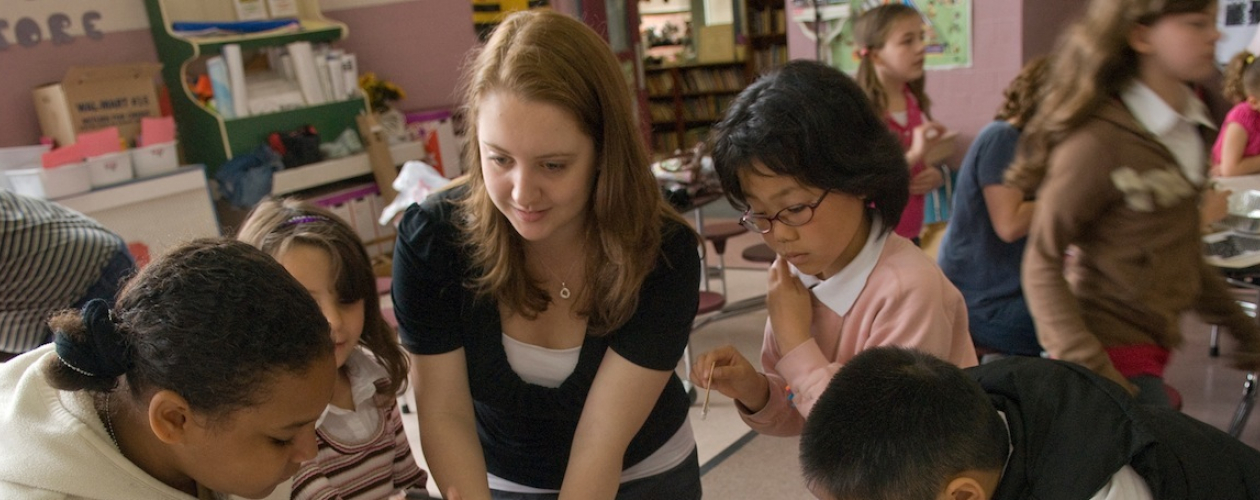 girl teaching young students