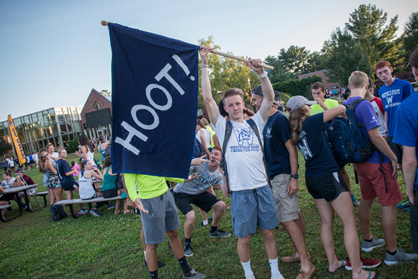 Student with flag that says hoot
