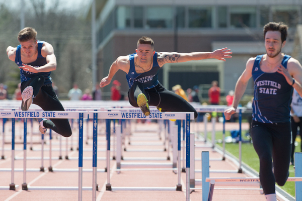 students jumping hurdles