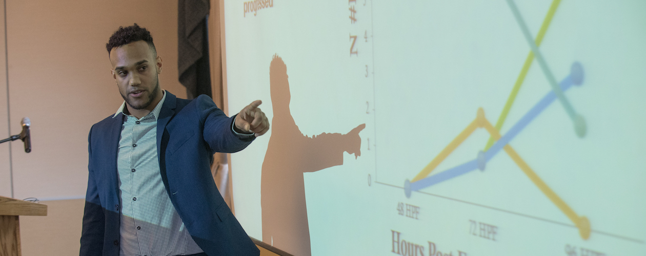 student pointing at graph