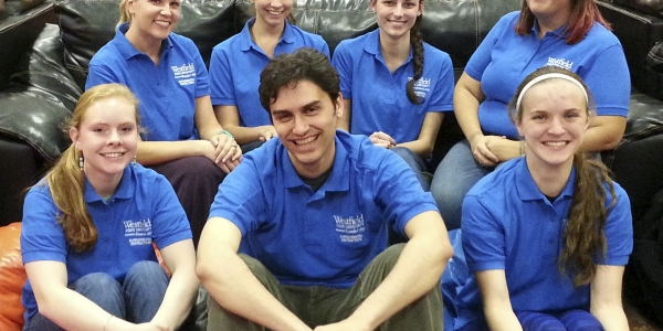 students wearing blue polos