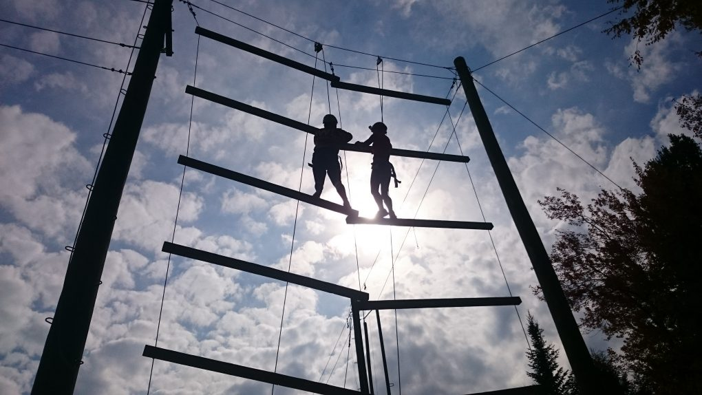 Two people on a rope